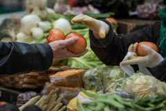 Buying in a traditional fruit market Stock Photos