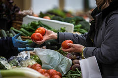 Buying in a traditional fruit market Royalty Free Stock Photo