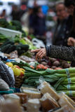 Buying in a traditional fruit market Stock Photography