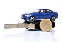 Buying a used car. Euro coin and car key with car on top Royalty Free Stock Photos