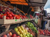 Buying vegetables at the farmers market. Russia. Gatchina. Autumn 2017. Royalty Free Stock Photos