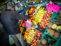 Buying vegetables stock images