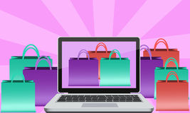 Buying via Internet. Packages with goods bought online using a laptop Stock Image