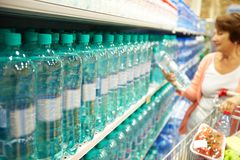 Buying water. Image of many plastic bottles with water in a shop Royalty Free Stock Photos