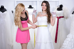 Buying Wedding Dress Royalty Free Stock Images