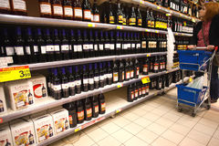 Buying wine in supermarket Stock Photography