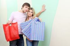 Buyings for home. Happy young couple standing with buyings at their home royalty free stock images