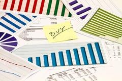 Buyl em cartas e em gráficos Foto de Stock Royalty Free