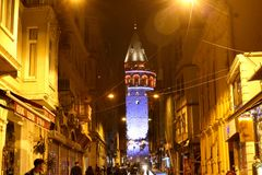 Buyuk Hendek Street Galata, Istanbul. Tower & Historical & Modern Buildigs & Malls, People, Street Lamps, Night Scene in Beyoglu Istanbul Turkey Royalty Free Stock Photo