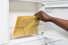 Buzón de Person Hands With Envelope In Foto de archivo libre de regalías