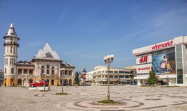 Buzau Palace And Winmarkt And H&m Market From Buzau Romania And Dacia Square Royalty Free Stock Images