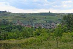 Buzd a enrichi l'église et le village, Roumanie Images stock