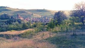 Buzd fortified church. The Buzd fortified church and Târnava village in Sibiu county, Romania stock images