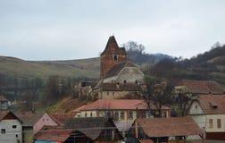 Buzd Versterkt Kerk en Dorp, Roemenië Royalty-vrije Stock Foto's