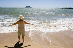 Buzios. Women looking the sea (third age royalty free stock image
