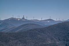Buzludzha and windmills. View of Buzludzha monument and windmills from the Shipka peak royalty free stock image
