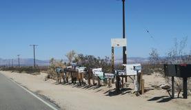 Buzones de correos en la carretera fotografía de archivo