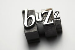 Buzz. The word Buzz photographed using old letterpress type. See my member portfolio for more vintage letterpress images Royalty Free Stock Images