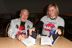 Buzz Aldrin. HUNTINGTON, NY-APR 5: Former astronaut Buzz Aldrin (L) signs his book No Dream Is Too High: Life Lessons From A Man Who Walked on the Moon at Book Stock Images