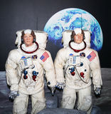 Buzz Aldrin and Neil Armstrong. US Astronauts Buzz Aldrin and Neil Armstrong are depicted walking on the moon.   The Apollo 11 mission landed on the moon on July Stock Photography