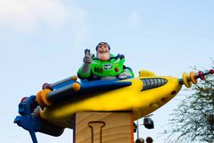 Buzz Lightyear waves and rides on a float in Disneyland Parade. Buzz Lightyear is riding on top of the giant Toy Factory float in Disneyland's A Christmas stock photography