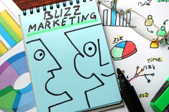 Buzz marketing. Written on a blue paper Royalty Free Stock Images