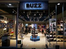 BUZZ store in the mall at AFI Palace Cotroceni, Romania. BUZZ store in the mall - the store contains the largest range of footwear models in different areas of stock image