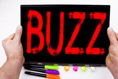 Buzz text written on tablet, computer in the office with marker, pen, stationery. Business concept for Buzz Word llustration white. Background with space royalty free stock photos