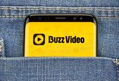 Buzz vide mobile app on Samsung s8. MONTREAL, CANADA - December 23, 2018: Buzz video android app on Samsung s8 screen, topbuzz, buzzvideo, application royalty free stock photo
