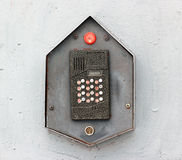 Buzzer door intercom on a grey wall Royalty Free Stock Photo