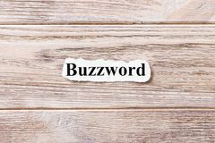 Buzzword of the word on paper. concept. Words of Buzzword on a wooden background stock photo