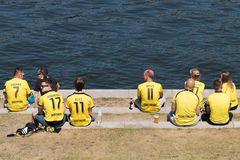 BVB Fans / Borussia Dortmund Fans wearing tricots and sitting on Royalty Free Stock Photo