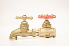 BVintage brass faucet with a shut-off valve Royalty Free Stock Image