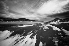 Bw belmeken. Black and white high contrasted landscape with dramatic sky and cold high mountain lake Stock Photography
