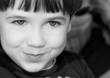 BW boy portrait. Portrait of boy with smiley face and funny expression Stock Images