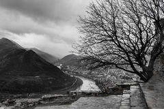 Bw cloudy mountain landscape with tree, river and town Mtskheta Stock Photo