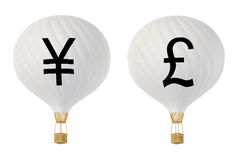 Bw currency hot air balloons: Yen and Pound Royalty Free Stock Photography