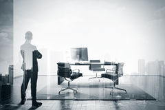BW double exposure of businessman in contemporary office Royalty Free Stock Images