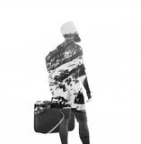 BW double exposure of a man holding suitcase. Isolated, square Royalty Free Stock Images