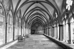 BW Exteriort Salisbury Cathedral Cloisters. Black and White image of the external covered walkway of the Salisbury Cathedral Cloisters. An exterior walkway Stock Photos