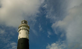 BW lighthouse. One BW Lighthouse in light cloudy Sky on the Iland of Sylt in the north of Germany Stock Photography