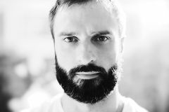 BW portrait of a bearded man wearing white tshirt Stock Images