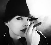 BW portrait of brunette smoking a cigar Stock Images