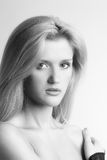 BW portrait of one young blonde with long hair Royalty Free Stock Photography