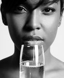 Bw portrait of a woman drinking champagne. Bw Stock Image