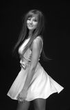 BW portrait of young woman. In white dress on a dark background stock photos