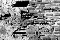 BW Wall. Ancient brick wall in black and white stock photography