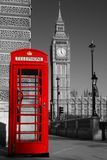 BW Westminster phone box. Westminster phone box in colour with the Palace of Westminster in black and white in the background Royalty Free Stock Images