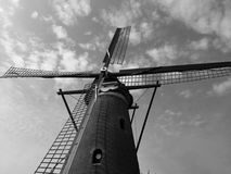 BW Windmill 2. Black and white image of a windmill close up with clouds in the sky. Space for text Royalty Free Stock Photo