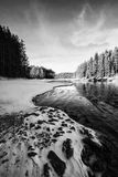 Bw winter. High contrasted vertical black and white winter landscape with frozen high mountain lake Royalty Free Stock Image